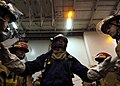 US Navy 070531-N-0916O-045 Damage Controlman 2nd Class Jawan Venable gives instructions to crew members of repair locker 1B during a general quarters drill on board nuclear-powered aircraft carrier USS Enterprise (CVN 65).jpg