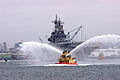 US Navy 070531-N-8327R-071 Tugboats spray arches of water in celebration of the arrival of amphibious assault ship USS Boxer (LHA 4) to her homeport at Naval Base San Diego.jpg