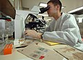 US Navy 070905-N-0194K-029 Lt. Paul Graf, a microbiology officer aboard Military Sealift Command hospital ship USNS Comfort (T-AH 20), examines wound cultures in the ship's microbiology laboratory.jpg