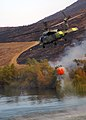 US Navy 071023-N-3069F-041 An MH-60S Seahawk assigned to Helicopter Sea Combat Squadron (HSC) 85, lifts a full 420-gallon extinguishing trough from a local reservoir near the raging wildfires in San Diego County.jpg
