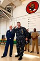 US Navy 090220-N-3013W-093 Master Chief Petty Officer of the Navy (MCPON) Rick West is assisted by Aviation Structural Mechanic 3rd Class Tifani Vesey in delivering a Navy.jpg