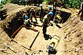 US Navy 090407-M-4213L-011 356th Aviation Engineer Group and U.S. Navy Seabees place wooden structures during the construction of a water wall.jpg
