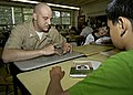 US Navy 090526-N-4649B-030 Mass Communication Specialist 1st Class Eric Rowley explains the meaning of his service ribbons to students at East Brook Middle School.jpg