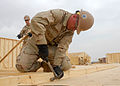 US Navy 090916-N-9564W-038 Construction Electrician Constructionman Matthew Bourdon, assigned to Naval Mobile Construction Battalion (NMCB) 74, builds a wall panel for a Southwest Asia Hut.jpg