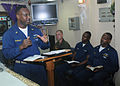 US Navy 091204-N-2439G-006 Chief Yeoman Leon Whaley leads a non-denominational religious service aboard the multi-purpose amphibious assault ship USS Wasp (LHD 1).jpg