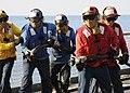US Navy 100123-N-1082Z-014 Sailors aboard the amphibious dock landing ship USS Ashland (LSD 48) participate in a flight deck firefighting drill.jpg