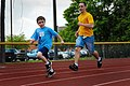 US Navy 100421-N-1522S-004 Logistic Specialist 2nd Class William Hoffman runs with a Special Olympics participant at the 14th annual Georgia Area 16 Special Olympics at Naval Submarine Base Kings Bay.jpg