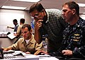 US Navy 100823-N-7498L-062 Lt. Cmdr. Gregg Bento, left, Shawn Morrissey and Capt. John Polowczyk provide logistics support during the region operations center's Liberty Champion exercise.jpg