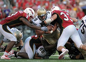 Alex Wujciak - Wujciak (right) tackles a Navy player.