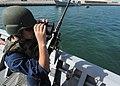 US Navy 101215-N-3415O-055 Gunner's Mate Seaman Nicholas Hagen, assigned to the guided-missile cruiser USS Lake Champlain (CG 57), scans the horizo.jpg