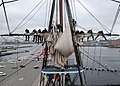 US Navy 110428-N-7642M-666 Sailors practice furling and unfurling a sail aboard USS Constitution for the first time since the ship began a restorat.jpg