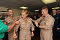 US Navy 110731-N-XE109-005 Rear Adm. Nora W. Tyson is pinned to rear admiral upper half by Capt. Jeffery A. Davis, left, and Capt. Brian E. Luther.jpg
