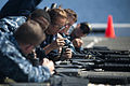 US Navy 110817-N-PB383-009 Sailors reload their M16 service rifle magazines during small arms qualifications aboard the San Antonio-class amphibiou.jpg