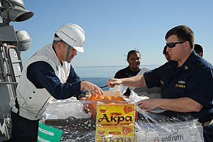 US Navy 111210-N-NP071-044 Sailors verify the freshness of fruit.jpg