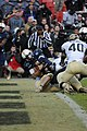US Navy 111210-N-OA833-949 U.S. Naval Academy quarterback (^2) Kriss Proctor scores a touchdown during the 112th Army-Navy Football game at FedEx F.jpg