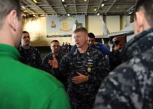 US Navy 120112-N-VH054-127 Master Chief Petty Officer of the Navy (MCPON) Rick D. West answers questions from Sailors aboard the aircraft carrier U.jpg