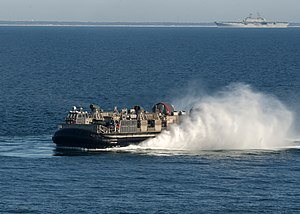 US Navy 120131-N-NL541-138 A landing craft air cushion (LCAC) from Assault Craft Unit (ACU) 4 returns to the amphibious assault ship USS Wasp (LHD.jpg