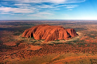 Monolith - Uluru, Northern Territory, Australia, is often referred to as the biggest monolith, but that is generally avoided by geologists. While the surrounding rocks were eroded, the rock survived as sandstone strata making up the surviving Uluru 'monolith'.