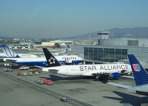 Star Alliance - Three United planes at San Francisco International Airport. One is wearing Star Alliance Livery.