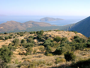 Pseira - Pseira island, in the distance, with the archaeological site of Kavousi Vronda in the foreground. View from the south.