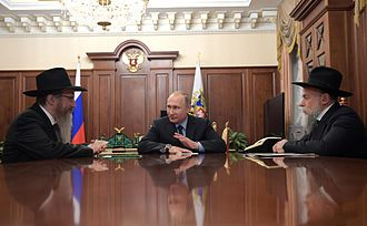 Chabad - Russia's Chief Rabbi Berel Lazar (left) speaks with Russian President Vladimir Putin, 28 December 2016