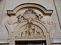 Vršovice, kostel svatého Mikuláše, reliéf nad vstupem.jpg