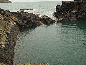 Diffraction - Circular waves generated by diffraction from the narrow entrance of a flooded coastal quarry