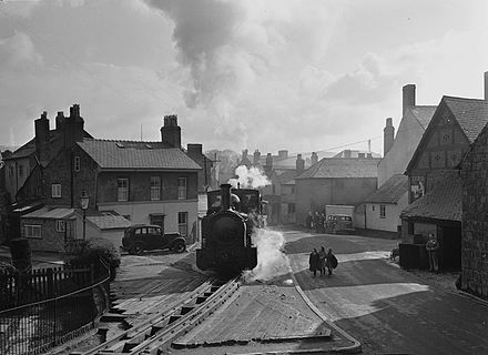 Train in the streets of Welshpool (1950) Welshpool to Llanfair Caereinion railway line (12989519473).jpg