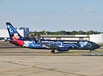 WestJet Boeing 737-8CT C-GWSZ (Walt Disney Workd Sorcerer Mickey livery).jpg