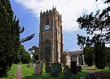 A church tower with churchyard and headstones in the foreground