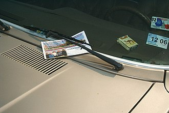 Tract (literature) - Tracts are often left in places with high amounts of public traffic. This tract was left under a vehicle windshield wiper.