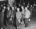 Witnesses at the International Military Tribunal wait for lunch during a recess.jpg