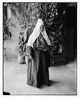 Woman wearing dowry necklace. LOC matpc.06847.jpg