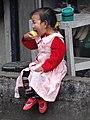Young Girl Eating an Apple - Ghum (Ghoom) - Near Darjeeling - West Bengal - India (12431488515).jpg
