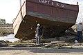 (Hurricane Katrina) Venice, LA, 12-01-05 -- FEMA special debris Contractors work on removing this boat from Highway 23. Debris and other materials including boats complicates debris - DPLA - 97b8199593d0012069cbec0241ad395b.jpg