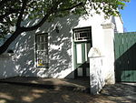 This historic dwelling-house is a typical double-storeyed town house of the second half of the 19th century. The property forms an essential part of the traditional architectural street scene of Dorp Street, and thus also of the historic core of Stellenbosch.