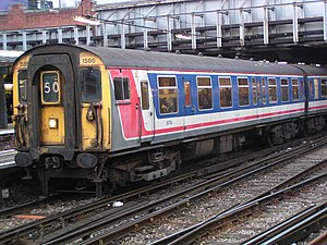 "Privatisation of British Rail - A 1950s Mk1-based Class 411 (4-CEP) ""slam-door"" EMU at London Victoria station, in Network SouthEast livery (March 2003)"