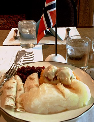 Norwegian diaspora - Norwegian Constitution Day dinner in the United States with lutefisk, rutabaga,  lingonberries, and lefse
