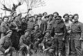 1945 משה שרת מבקר את חיילי הבריגאדה באיטליה בצ עומד ליד משה שרת - iבן btm11286.jpeg