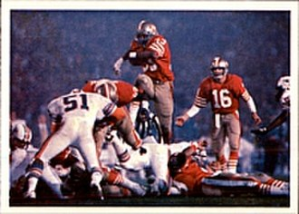 Super Bowl XIX - Roger Craig (middle) rushes past the Dolphins' defense during Super Bowl XIX.