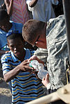 2-319th, Black Falcons, Deliver Much Needed Food and Water in Port-au-Prince DVIDS246881.jpg
