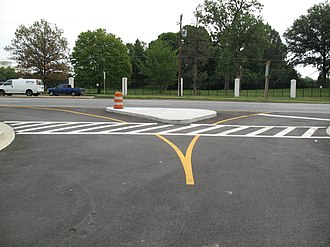 Right-in/right-out - A right-in/right-out intersection at the entrance to the National Institutes of Health along Maryland Route 355 in Bethesda, Maryland, United States.