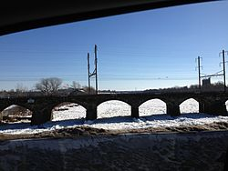 2014-01-24 13 54 44 View south along the icy Delaware River from the Trenton-Morrisville Toll Bridge.JPG