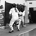 2nd Leonidas Pirgos Fencing Tournament. Lunge by Nefeli Rodopoulou, 8th parry by Eleanna Gousi.jpg