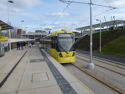 A tram at Etihad Campus tram stop which opened in February 2013 3037 - Etihad Campus.jpg