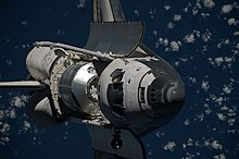 Discovery approaches the ISS with Leonardo in its payload bay