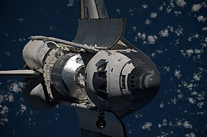 STS-128 - Discovery approaches the ISS with Leonardo in its payload bay