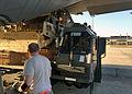 3rd APS Airmen load C-130 150121-F-ZS275-002.jpg