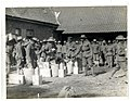 9th Gurkhas drawing rations at a French farm house St Floris, France (Photo 24-55).jpg