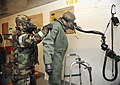 AFE helps 25th FS suit up for CBRN exercise 140115-F-FM358-278.jpg